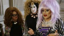 In this Sept. 17, 2014 file photo, drag queens from left, Lil Ms. Hot Mess, Sister Roma and Heklina, take turns speaking about their battle with Facebook during a news conference at City Hall in San Francisco. (Eric Risberg/AP)