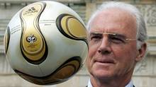 Franz Beckenbauer, President of Germany's World Cup organising committee, plays with a golden soccer ball during a presentation next to the Brandenburg gate in Berlin April 18, 2006. (TOBIAS SCHWARZ/REUTERS)