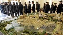 Police officers in Hangzhou maintain order after a model of a new housing estate was smashed by property owners upset that the asking price of new homes in the complex had been cut dramatically, making their own homes worth a lot less. (Lang Lang/Reuters/Lang Lang/Reuters)