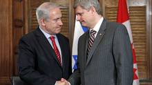 Prime Minister Stephen Harper shakes hands with Israeli Prime Minister Benjamin Netanyahu during a meeting in Mr. Harper's Parliament Hill office on May 31, 2010. (CHRIS WATTIE/Reuters)