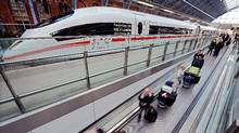 Eurostar passengers pass an ICE high speed train. (BEN STANSALL/AFP/Getty Images)