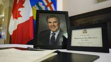 A book of condolence for former Alberta premier Jim Prentice is on display at the MacDougal Centre in Calgary on Oct. 17, 2016. (Jeff McIntosh/THE CANADIAN PRESS)