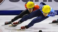 Michael Gilday (L) of Canada who came in second races Victor An of Russia who finished first in the men's 1000 meter race during the ISU Short Track World Cup competition in Calgary, Alberta, October 21, 2012. (TODD KOROL/REUTERS)