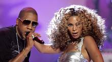 Jay-Z and Beyonce perform at the 2006 BET Awards at the Shrine Auditorium in Los Angeles June 27, 2006. (© Mario Anzuoni / Reuters/Mario Anzuoni / Reuters)