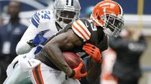 Dallas Cowboys' Morris Claiborne (24) chases down Cleveland Browns' Josh Gordon (13) on a short run after a reception by Gordon in the first half of an NFL football game Sunday, Nov. 18, 2012 in Arlington, Texas. (Brandon Wade/AP)