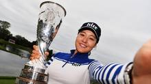 Chun In-gee of Korea imitates a selfie as she poses with the trophy after winning The Evian Championship on September 18, 2016 in Evian-les-Bains, France. (Stuart Franklin/Getty Images)