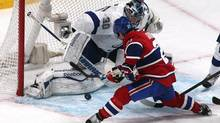 Tampa Bay Lightning goalie Ben Bishop (30) makes a save against Montreal Canadiens right wing Brian Gionta (21) during the third period at Bell Centre. (Jean-Yves Ahern/USA Today Sports)
