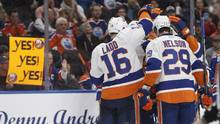 The New York Islanders celebrate a goal against the Edmonton Oilers during third period NHL action in Edmonton, Alta., on March 7, 2017. (JASON FRANSON/THE CANADIAN PRESS)