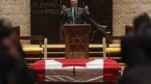 Former prime minister Paul Martin speaks during the funeral of former MP Herb Gray in Ottawa April 25, 2014. (Chris Wattie/Reuters)