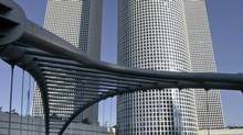Israelis walk on a bridge outside the Azrieli Towers in Tel Aviv April 28, 2008. (BAZ RATNER/REUTERS)