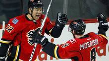 Calgary Flames' Jarome Iginla, left, celebrates his goal with teammate Brendan Morrison during first period NHL action against the Carolina Hurricanes in Calgary, Alta., Tuesday, Dec. 6, 2011. Iginla was named the NHL's first star of the week Monday after recording six points over three games.He had four goals and two assists to help the Flames record three victories last week.THE CANADIAN PRESS/Jeff McIntosh (Jeff McIntosh/CP)