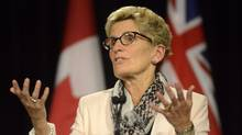 Ontario Premier Kathleen Wynne speaks to the media at Queen's Park in Toronto on Oct. 1, 2015. (MARTA IWANEK/THE CANADIAN PRESS)