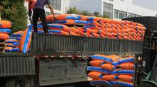 Workers use a forklift to load bags of fertilizer onto a truck at the plant of Hanfeng Evergreen Inc. in the city of Jiangyan, Jiangsu province, in a file photo. (Kevin Lee For The Globe and Mail)