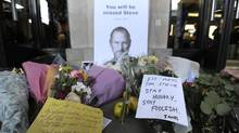 Notes are left with flowers and apples outside the Apple store in Covent Garden, central London, on October 6, 2011, following the death of Steve Jobs, co-founder and former chief executive of US technology giant Apple, at the age of 56. (CARL COURT/AFP/Getty Images)