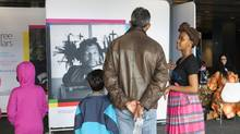 Kirstin Gollings Precious Rametsana with the Museum of AIDS in Africa speaks with a family visiting at the 'pop-up museum' and virtual memorial at the 20th International AIDS Conference, Melbourne, Australia in July.