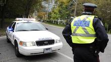 Toronto police block off Rosedale Valley Rd. at Park Rd. after a car accident took down a utility pole on Oct. 15, 2012. (Fred Lum/The Globe and Mail)