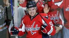 In this Jan. 1, 2009 file photo, Washington Capitals' Mike Green reacts after scoring a goal against Tampa Bay Lightning goalie Mike Smith during the first period of an NHL hockey game in Washington. (The Canadian Press)