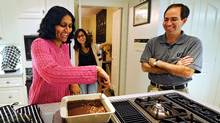 Oct. 13, 2009 - Shal Grant makes brownies as her husband Ross and daughter Kala look on at their home in Scarborough, Ont. Oct. 13/2009. Photo by Kevin Van Paassen/The Globe and Mail Oct. 13/2009 (Kevin Van Paassen/Kevin Van Paassen/THE GLOBE AND)