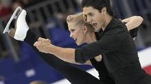 Canadian ice dancers Kaitlyn Weaver and Andrew Poje perform during a training ice dance session at the 2012 World Figure skating Championships in Nice, southern France. (Lionel Cironneau/AP)
