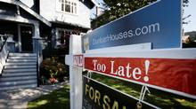 A real estate for sale sign is pictured in front of a home in Vancouver, British Columbia, Canada, September 22, 2016. (BEN NELMS/REUTERS)