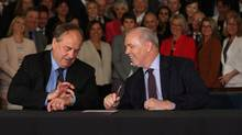 B.C. NDP leader John Horgan looks on as B.C. Green party leader Andrew Weaver checks the time before signing an agreement on creating a stable minority government during a press conference in the Hall of Honour at Legislature in Victoria, B.C., on Tuesday, May 30, 2017. (CHAD HIPOLITO/THE CANADIAN PRESS)