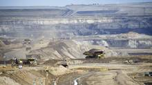 Heavy machinery operates in the pit at the Shell Albian Sands located in Alberta's oil sands north of Fort McMurray, Alberta . (Kevin Van Paassen/The Globe and Mail)