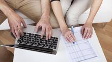 Young couple doing finances at laptop (Andrey Popov/Getty Images/iStockphoto)
