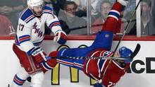 New York Rangers defenseman John Moore checks Montreal's Dale Weise (Ryan Remiorz/THE CANADIAN PRESS)