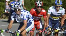 "Katusha Team rider and leader of the race Joaquim ""Purito"" Rodriguez (L) of Spain, Team Saxo Bank rider Alberto Contador (R) of Spain and cycle during the 14th stage of the Tour of Spain ""La Vuelta"" cycling race between Palas de Rei and Puerto de Ancares September 1, 2012. (MIGUEL VIDAL/REUTERS)"