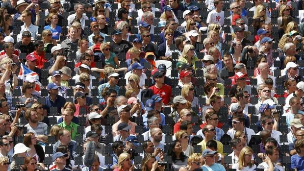 Spectators gathered to watch Usain Bolt of Jamaica and the other sprinters compete in his Round 1 Men's 100 metres heat during the 2012 Summer Olympic Games in London on August 4, 2012. (PHIL NOBLE/REUTERS)