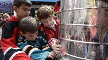 Children crowd around the Stanley Cup (Mary Altaffer)