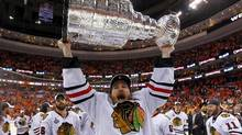 Chicago Blackhawks Duncan Keith celebrates with the Stanley Cup after the Blackhawks defeated the Philadelphia Flyers in Game 6 to win the NHL Stanley Cup Final hockey series in Philadelphia. (SHAUN BEST/SHAUN BEST/REUTERS)