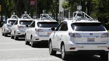 A row of Google self-driving cars are shown outside the Computer History Museum in Mountain View, Calif. (Eric Risberg/AP)