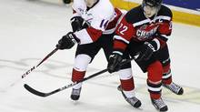 Team Orr's Laurent Dauphin (14) and Team Cherry's Nathan MacKinnon (22) move on the puck during the first period of the CHL/NHL Top Prospects Game at the Metro Centre in Halifax, Nova Scotia, January 16, 2013. (PAUL DARROW/REUTERS)