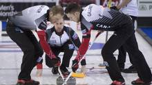 Canada skip Brad Gushue makes a shot as Geoff Walker and Brett Gallant sweep during the 15th draw against Italy at the Men's World Curling Championships in Edmonton, on April 6, 2017. (JONATHAN HAYWARD/THE CANADIAN PRESS)