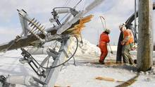A Badger Daylighting crew drills holes in the ground for the replacement hydro poles after a storm caused damage to hydro lines in Cambridge, Ont., in 2007. Badger is one of a number of smaller companies now offering dividends to investors. (Peter Lee/CP)