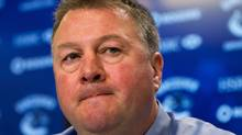 Vancouver Canucks president and general manager Mike Gillis pauses as he speaks to reporters in Vancouver, B.C., on Tuesday April 24, 2012. The Canucks, who finished in first place overall in the NHL this past season, were defeated by the Los Angeles Kings in their first round NHL hockey playoff series four games to one. THE CANADIAN PRESS/Darryl Dyck (Darryl Dyck/CP)