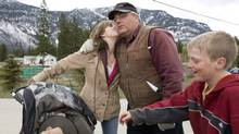 Winston Blackmore, the religious leader of the polygamous community of Bountiful, B.C., receives a kiss from one of his daughters as a son looks on in this 2008 photo. Mr. Blackmore was charged last year with practising polygamy, but those charges were later thrown out on technical legal grounds. (JONATHAN HAYWARD/Jonathan Hayward/The Canadian Press)