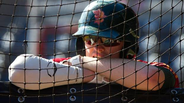 Boise Hawks' left fielder Trevor Gretzky, son of NHL hockey great Wayne Gretzky, watches batting practice as he waits his turn before playing the Vancouver Canadians in a minor league baseball game in Vancouver, B.C., on Saturday July 13, 2013. (DARRYL DYCK/THE CANADIAN PRESS)