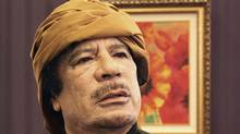 Libya's leader Muammar Gaddafi poses after an interview with TRT Turkish television reporter Mehmet Akif Ersoy at the Rixos hotel in Tripoli March 8, 2011. (STR/REUTERS)