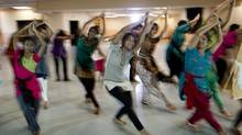 Dancers practice their routines for an upcoming performance at FeTNA, an annual gathering of Tamil cultural organizations across North America. (Peter Power/The Globe and Mail)