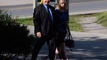 MP Dean Del Mastro arrives at court with wife Kelly in Peterborough, Ont., on June 23, 2014. (Sean Kilpatrick/THE CANADIAN PRESS)