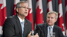 Minister of State for Science and Technology Gary Goodyear delivers some remarks as Chair Tom Jenkins releases the final report of a panel review of federal support to reasearch and development at a news conference in Ottawa, Oct. 17, 2011. (Adrian Wyld/The Canadian Press/Adrian Wyld/The Canadian Press)