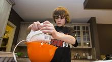 Zac Buller, 12, of Calgary makes a banana bread recipe from scratch in his parents kitchen on Jan. 09, 2013. The Grade 7 student at Twelve Mile Coulee School in Calgary, Alberta has taken a liking to his twice-a-week cooking class Digital Bits & Bites. (Chris Bolin for The Globe and Mail)