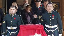 Kathy Cirillo, the mother of Cpl. Nathan Cirillo, reacts while following pallbearers carrying his casket from a funeral home in Ottawa October 24, 2014. Cirillo was killed during a shooting incident at the Canada War Memorial in Ottawa on October 22. Canada vowed on Friday to toughen laws against terrorism as an opinion poll showed a majority of Canadians lacked confidence in their security services' ability to deter homegrown radicals who struck twice in the past week. (Reuters)