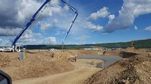 Concrete is poured on the south bank of the Site C hydroelectric dam project.