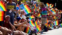 People watch the Vancouver Pride Parade on Aug. 4, 2013. (DARRYL DYCK/THE CANADIAN PRESS)