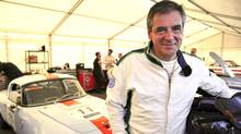 Former French Prime Minister and candidate for the right-wing Les Republicains (LR) party primary ahead of the 2017 presidential election Francois Fillon, poses on a 1956 Lotus Elan after a relay as he takes part in the Le Mans Classic car race, on July 8, 2016 in Le Mans, western France. (JEAN-FRANCOIS MONIER/AFP/Getty Images)