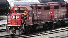 Canadian Pacific Railway cars at a railyard in Calgary in a 2012 photo. (Jeff McIntosh/The Canadian Press)