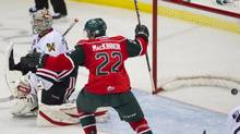 Halifax Mooseheads centre Nathan MacKinnon celebrates a goal as Portland Winterhawks goaltender Mac Carruth looks on during the second period of Memorial Cup action in Saskatoon, Sask., on Saturday, May 18, 2013. The Mooseheads won 7-4. The two team's meet in Sunday's tournament final. (Liam Richards/THE CANADIAN PRESS)